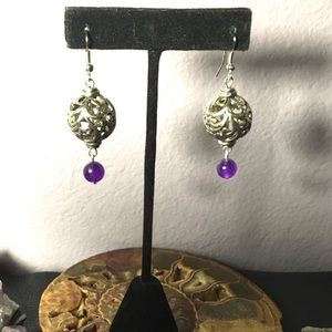 Hollow silver spheres w/ swirling floral designs
